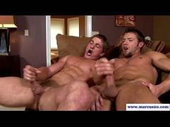 Muscular studs sixtynining on big love couch