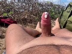 Hands free cumshot at beach